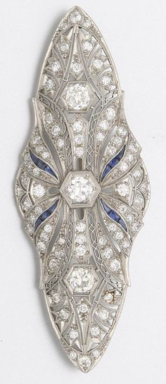 PLATINUM, DIAMOND AND SAPPHIRE BROOCH. Art Deco or Art Deco style.