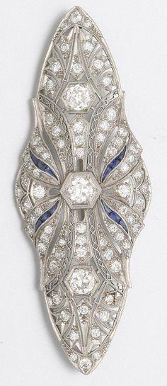 PLATINUM, DIAMOND AND SAPPHIRE BROOCH. Art Deco or Art Deco style.