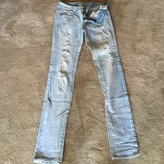 """Skinny jeans Light bleach destroyed denim. Stretch. Low rise. 32"""" inseam American Eagle Outfitters Jeans Skinny"""