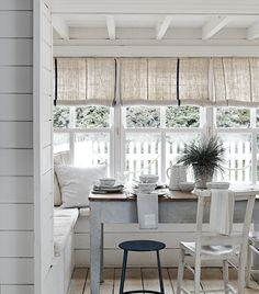 Serve up a feast on rustic wooden boards, with nautical runners and striped cutlery and you'll feel like you're dining beachside.