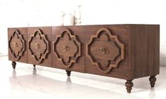 "A modern Moroccan inspired credenza made of walnut..... this multi-functional piece features a Moroccan molded motif, 5inch turned legs, and brass ring pulls. 8' Long / 18"" Deep / 23"" Tall * To inquir"