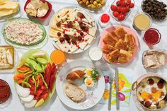 The elaborate Saturday morning spread in front of Doga includes honey and clotted cream, called kaymak, on toasted bread; green and black olives; fried eggs with a spicy sausage called sucuk; butter; hard-boiled eggs; thick grape syrup (pekmez) with tahini on top; an assortment of sheep-, goat- and cow-milk cheeses; quince and blackberry jams; pastries and bread; tomatoes, cucumbers, white radishes and other fresh vegetables; kahvaltilik, biber ...