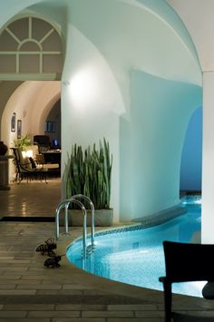 Indoor pool integrated into home.  I like the idea but not just open like this.  More for the fact that the chlorine smell would be throughout the house than anything.  Although if you make it a salt water pool.......