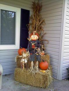Cute scarecrows, pumpkins and cornstalks
