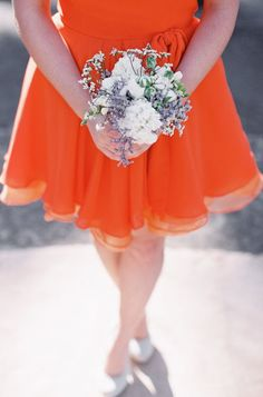 I could see this on my maids... maybe. :)  Tangerine bridesmaid gowns - Feather & Stone Photography