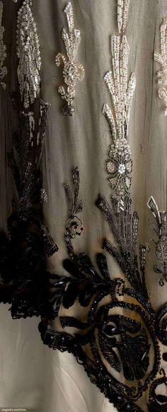 """Augusta Auctions 2-piece, empire, black silk net over ivory silk satin, black velvet sash & bow, all beaded w/ white & jet beads, B 32"""", High W 24"""", Skirt L 43""""-60"""", (some tears in beaded areas, net fragile & missing beads) very good. BM"""