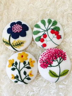 Hand embroidered brooches byNina
