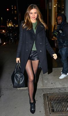 miranda kerr. leather shorts. sheer tights.