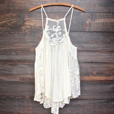 Gorgeous bohemian oversize/flowy semi-sheer tank with lace panels throughout. Unlined. imported.