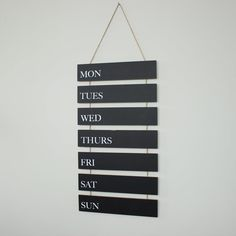 Hanging Wooden Days of The Week Notice Board A unique black notice or memo board hung with rope Each individual plaque has a day of the week painted on in white paint Would make the finishing touch to your kitchen or dining room The sign has a string loop hanging so it can be easily displayed on a door/ wall. £16.95 from www.melodymaison.co.uk