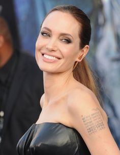 Pin for Later: Angelina Jolie Has the Original Plump Pucker of Hollywood 2014 A sultry smoky eye, nude lip, and simple ponytail made up Angelina's beauty ensemble for the LA Maleficent premiere.