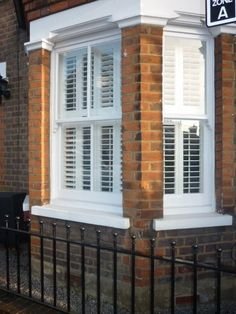 Visit Stylish Shutters and view our gallery of shutters for bay windows. Specialists in shutter design and installation of all types of bay window shutters. Bay Window Exterior, Terrace House Exterior, Interior Window Shutters, Wooden Shutters, Window Shutters Inside, Windows With Shutters, Bay Window Living Room, Shutter Designs, Home Exterior Makeover