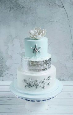 Silver, baby blue and white Winter wedding cake
