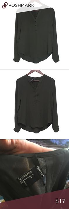 F21 - Dark Green Blouse Very Nice condition, tag falling off (see in photo) does not affect appearance of shirt, dark green, long sleeves, one button at wrist, sheer chiffon, 100% polyester, v neckline with 3 buttons down. ❌TRADES❌ Forever 21 Tops Blouses