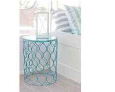 Old wire trash can, painted and flipped upside down to create a cute bed side table!
