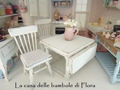 Kitchen table and two chairs - 1/12 dolls house dollhouse miniature. $57.00, via Etsy.