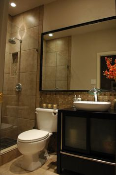 to make a small master bath feel bigger: large miror and walk in shower with glass door