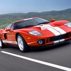 The Ford GT is an American mid-engine two-seater sports car. Ford Motor Company produced the Ford GT for the 2005 to 2006 model years. The designers drew inspiration from Ford's racing cars of the Cool Muscle Cars, Muscle Cars Vintage, Vintage Cars, Cool Cars, Ford Gt40, Maserati, Bugatti, Ferrari, Us Cars