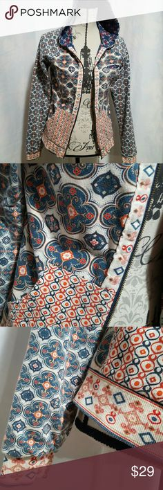 BILLABONG reversible hoodie jacket Super fun colors, Billabong, reversible jacket,  zips up the front with a metal zipper,  hooded,  in excellent condition,  100% cotton fabric with slight stretch,  incredible design. Can't lose with this one two shirts in one.  Slight embroidery on each side tag is located in the pocket.   Please ask any and all questions before purchasing this item. Billabong Tops Sweatshirts & Hoodies