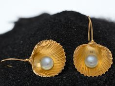 Hand made sterling silver shell earrings with fresh water pearls by giousouri.gr
