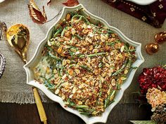 Lemon-Almond Green Bean Casserole Recipe   This is the perfect old-school green bean casserole for your holiday menu, but without any cream of mushroom soup. Every aspect of this casserole is homemade and perfectly good. We switched out the traditional ingredients, mushrooms and fried onions, for the fresh taste of panko (Japanese-style breadcrumbs) and sliced almonds for a crispy topping. The fresh addition of lemon adds a bright, light feel without sacrificing any of the satisfying, hearty