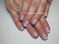 Gel nails in a classic french manicure with white shimmer tips and a light purple glitter accent. Nail Artist: Lisa Rattai Located: YEG Twitter: @beautynthebooks Instagram: @beautyandthebooks