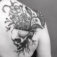 Incredible dark nature tattoo - plants growing from a skull - Skin Deep Tales