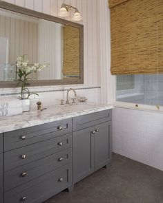 Wick Design - bathrooms - gray, double vanity, cabinet, calcutta, marble, counter top, subway tiles, backsplash, bamboo, roman shades, gray, slate, tiles, floor, gray bathroom, gray bathroom cabinets, gray bathroom vanity, gray double bathroom vanity,