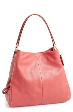 Pretty in pink! Sporting this chic Coach leather shoulder bag for a subtle pop of color.