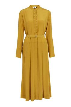 Take a stylish step back in time in this shirt-style dress by Unique. Crafted in pure silk, this dress comes in a '70s-inspired mustard hue, cut in a classic midi length. Other features include a frill button placket fastening, exaggerated cuffs and belt fastening at the waist. #Topshop
