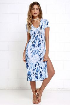 If you're craving a bit of ocean air and a sandy beach, the Let Me Sea Blue Tie-Dye Midi Dress will take you there! Soft stretch knit (with a blue and ivory tie-dye print) makes a classic t-shirt-style bodice with a V-neck and short sleeves. Sheath silhouette flutters to a midi skirt with twin side slits.