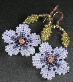 peyote earrings | Use circular peyote stitch to make delicately shaped blossoms. Suspend ...