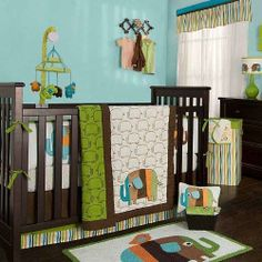 The Zutano elephant crib bedding collection features a reversible cotton filled quilt embroidered with a parade of chocolate stitched elephant silhouettes. The quilt features a large elephant applique with orange, lime, aqua, teal, chocolate and mocha fabrics and a dimensional peekaboo ear for baby to grasp.