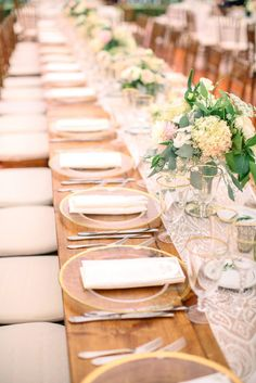 A vintage table and table runner complimented by some classic, pretty flower arrangements.