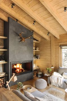 Dreamy rustic cabin in the middle of a Spanish forest. Dreamy rustic cabin in the middle of a Spanish forest. This rustic cabin in the middle of a forest in Spain took three years to renovate, maintaining the romanticism of a logger-style cabin. Cabin Fireplace, Modern Fireplace, Living Room With Fireplace, Living Room Cabin, Living Area, Chalet Modern, Rustic Modern Cabin, Modern Cabin Interior, Chalet Interior