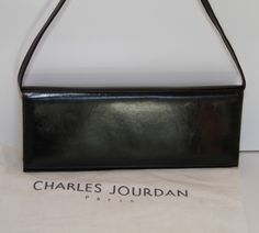 Charles Jourdan - Black Leather Clutch You can find this item and more on www.handbagconsignmentshop.com