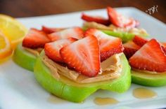 Get cute with your snacks... This is a great snack option if you're on the 10-day green smoothie cleanse or anytime really... apples, peanut butters, topped with a few strawberries...and yes, a few strawberries won't work against your success! ENJOY! -  JJ Smith