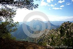 Photo about This is a view from a high elevation outside of Gandesa Spain looking towards a natural Reserve called Parc Natural Els Ports. Image of pools, crossing, elevation - 81236623 Mountain View, The Outsiders, Spain, Symbols, Stock Photos, Mountains, Natural, Outdoor, Image