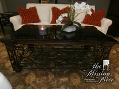 Gated wrought iron based coffee table with think black and bronze marble top. Measures 54*32*23.