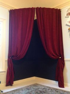 Children's playhouse theater and stage. So easy!! 4 supplies: Chalkboard paint, Curved shower rod, long curtains, and tie backs. Endless fun with the chalkboard backdrop to create different scenes.