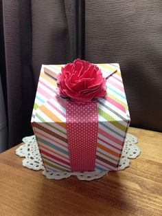 """Box made w/ envelope hole punch! 4 1/4"""" tall, 3 3/4"""" wide. Flower on belly band made w/ Stampin up Blossom hole punch. Used 7 flowers."""