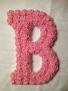 "9"" Wooden Letter covered with Pink fabric yo-yos and accented with pearls hangs on wall or door - $21.50 each) - http://www.etsy.com/search?q=fabric+yoyos&view_type=gallery&ship_to=US&page=10"