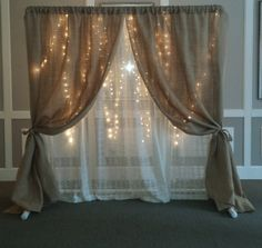 Something like this, with lights and burlap but not hanging down like that. And much prettier!!!