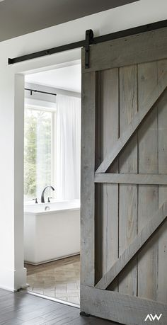 A wooden barn door brings a dynamic and subtle nod to your eclectic home design…