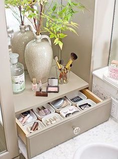 \Organize makeup and beauty supplies in a pretty countertop drawer complete with individual storage cups. Use a different container for eyeshadow blush lipstick and nail polish so that they are easy to find rather than loose at the back of a drawer. Organizing all of your makeup brushes bristle sides up in a glass not only keeps them handy in one place but also protects them from damage and wear.\