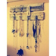 Old fence boards and jewelry. <3   Top board family name, bottom hooks