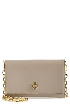 Obsessed with pairing this gorgeous Tory Burch leather wallet on a chain with jeans, pumps and a cute oversized sweater.