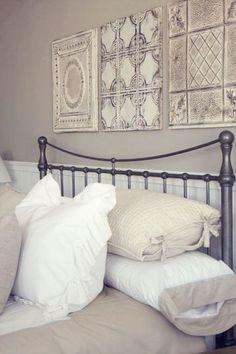 Tin panels above bed They can also be decorative pieces on their own---love this look!!