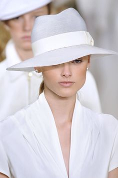 Ralph Lauren at New York Spring 2009, white hat and pearl earrings.