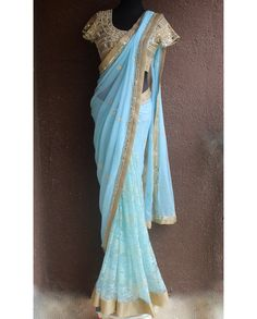 Light Ice blue pure chiffon pallu with kundan work and same colour chantilly lace net pleats with mirror work border